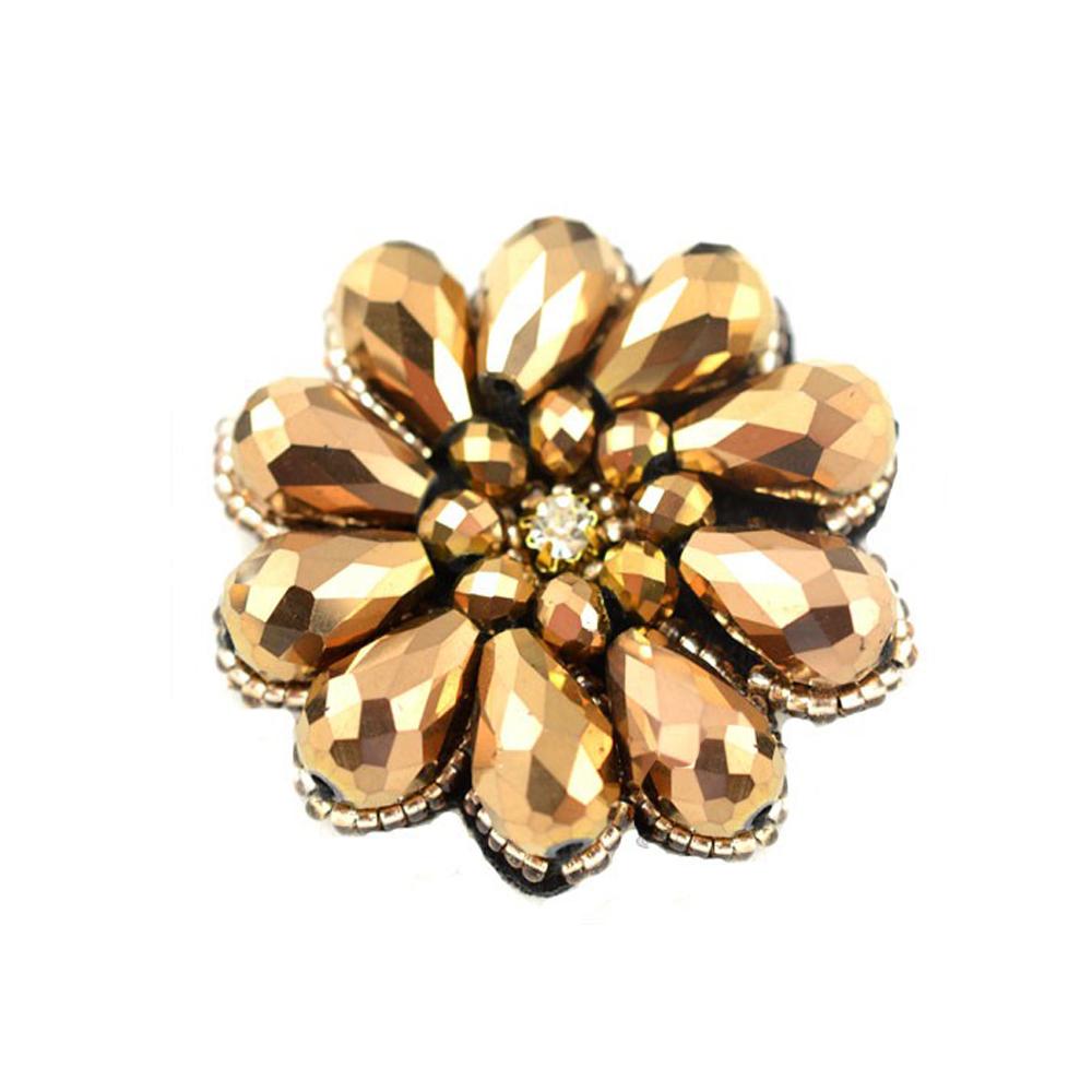 Aplicacion flor de cristal dorado