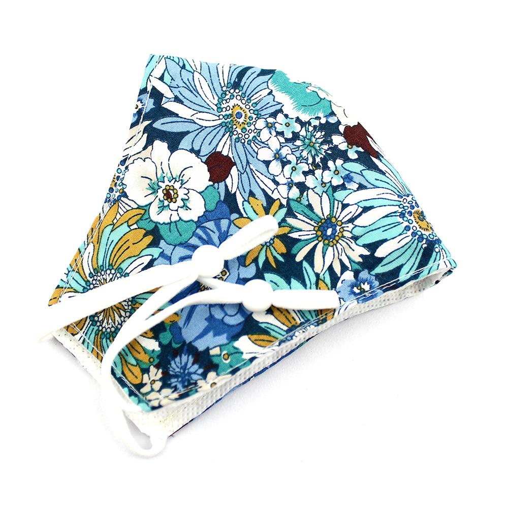 Mascarilla de tela redonda floral azul petróleo