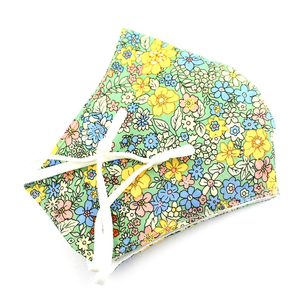 Mascarilla de tela redonda floral vede agua